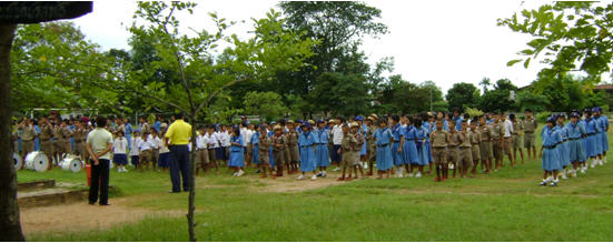 Kids at an outdoor assembly